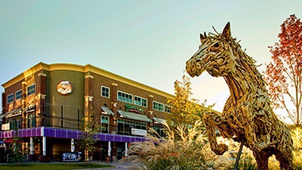 Regal Plaza Exterior with Horse Sculpture